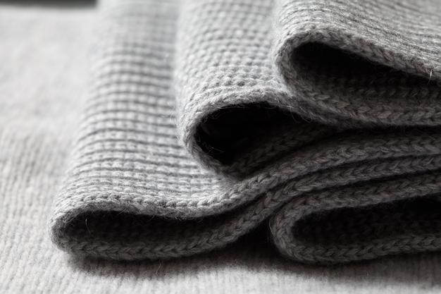 closeup-macro-texture-knitted-wool-fabric-clothing-surface-with-folds_338799-2506